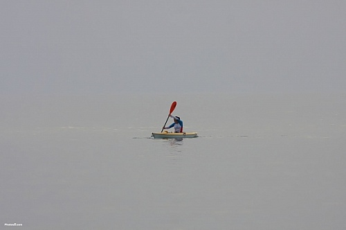 alone in the ocean on a kayak
